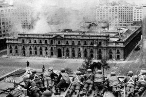 Chilean Army troops positioned on a rooftop fire on the La Moneda Palace 11 September 1973 in Santiago, during the military coup led by General Augusto Pinochet which overthrew Chilean constitutional president Salvador Allende, who died in the attack on the palace. Next 10 December 2007 marks the first anniversary of Pinochet's decease at the Military Hospital in Santiago, where he had been admitted a week before following a heart attack. AFP PHOTO (Photo credit should read OFF/AFP/Getty Images)