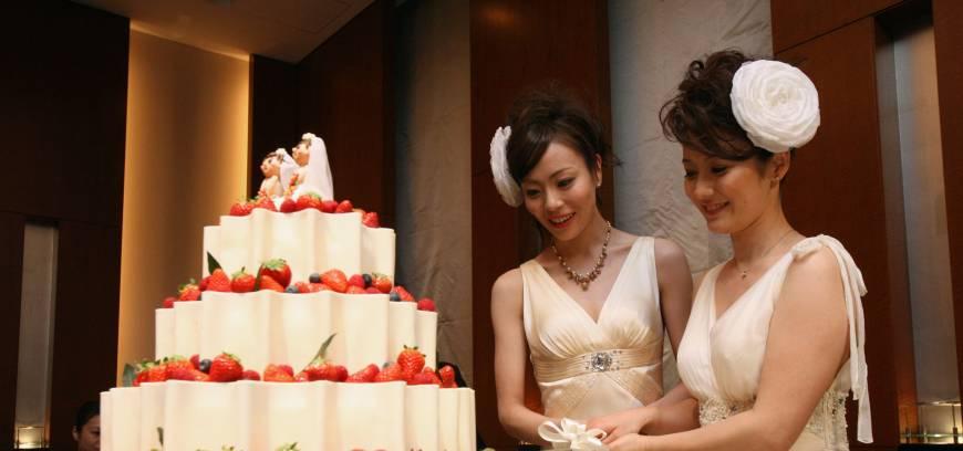 japan Dream come true Koyuki Higashi (left) and Hiroko cut the cake at their weddYOSHI YAMAGUCHI,AFP-JIJI