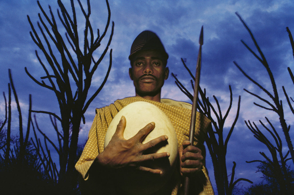 Man with Elephant Bird Egg, Madagascar, 1985